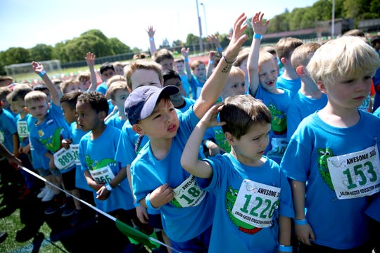 Kindergarten boys answer questions before running during the 37th annual Awesome 3000 at Bush's Pasture Park in Salem on May 4, 2019.
