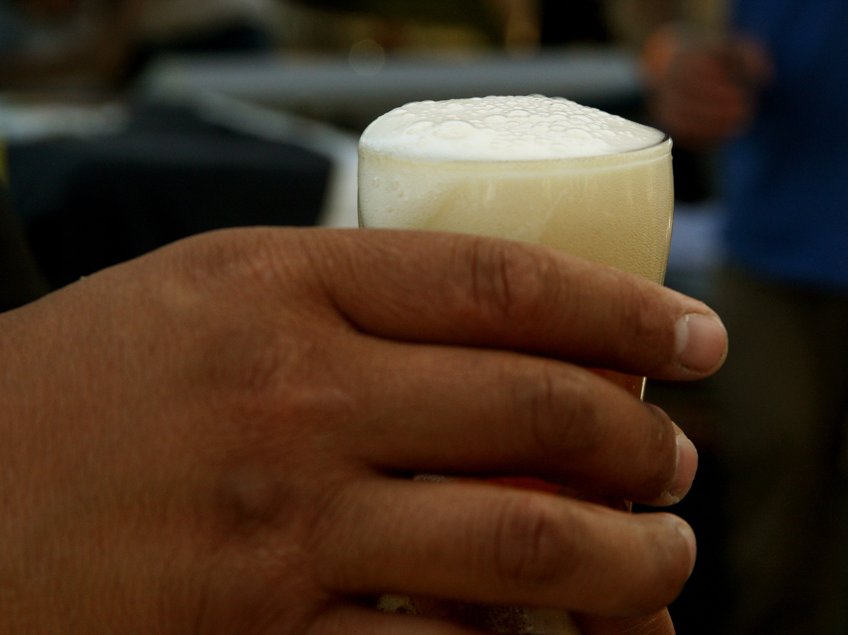 A customer waits for the foam in his beer to settle. May 4, 2019.