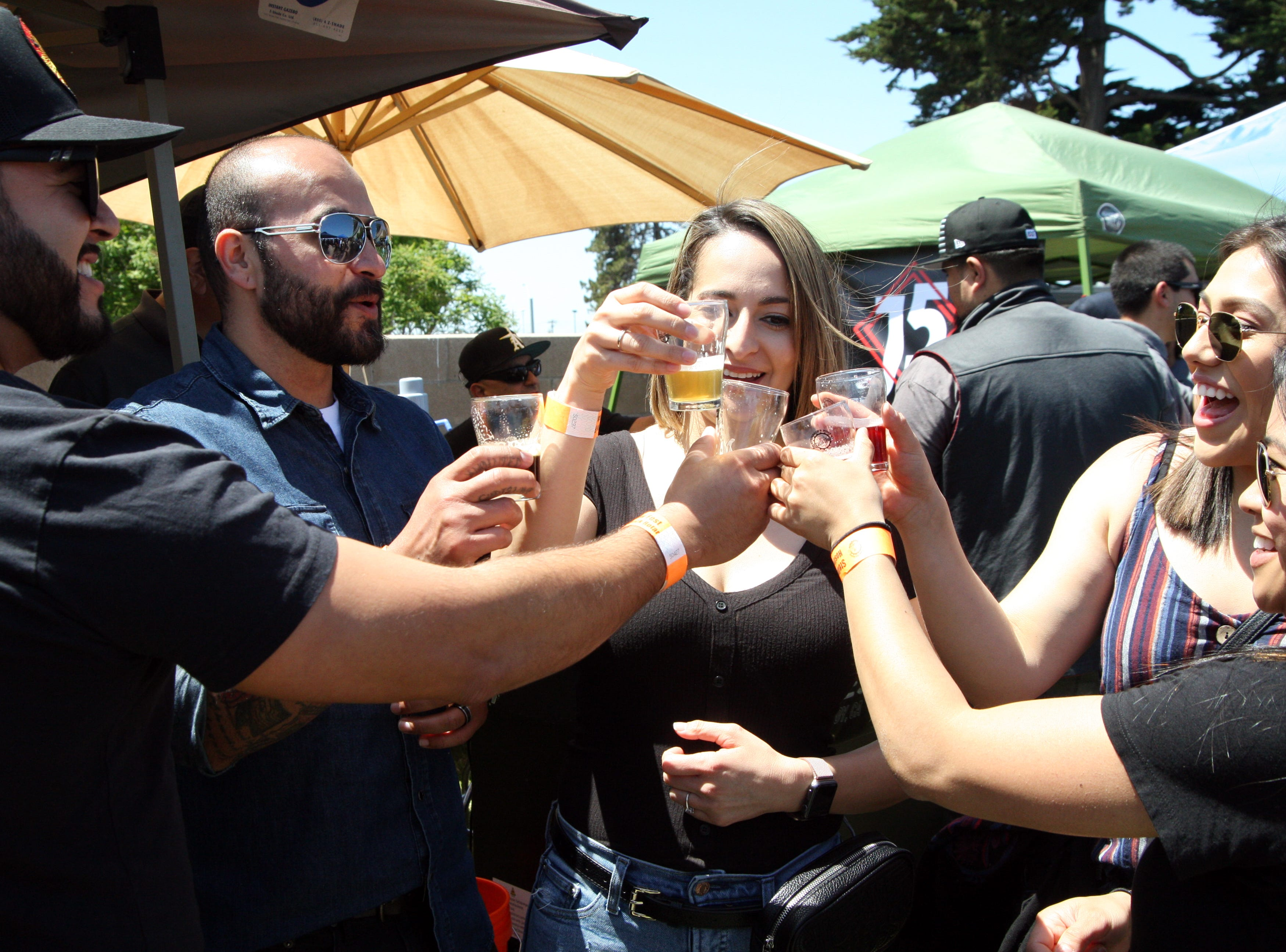 A group of friends or strangers toasts each other at the Brew Fest Saturday. May 4, 2019.