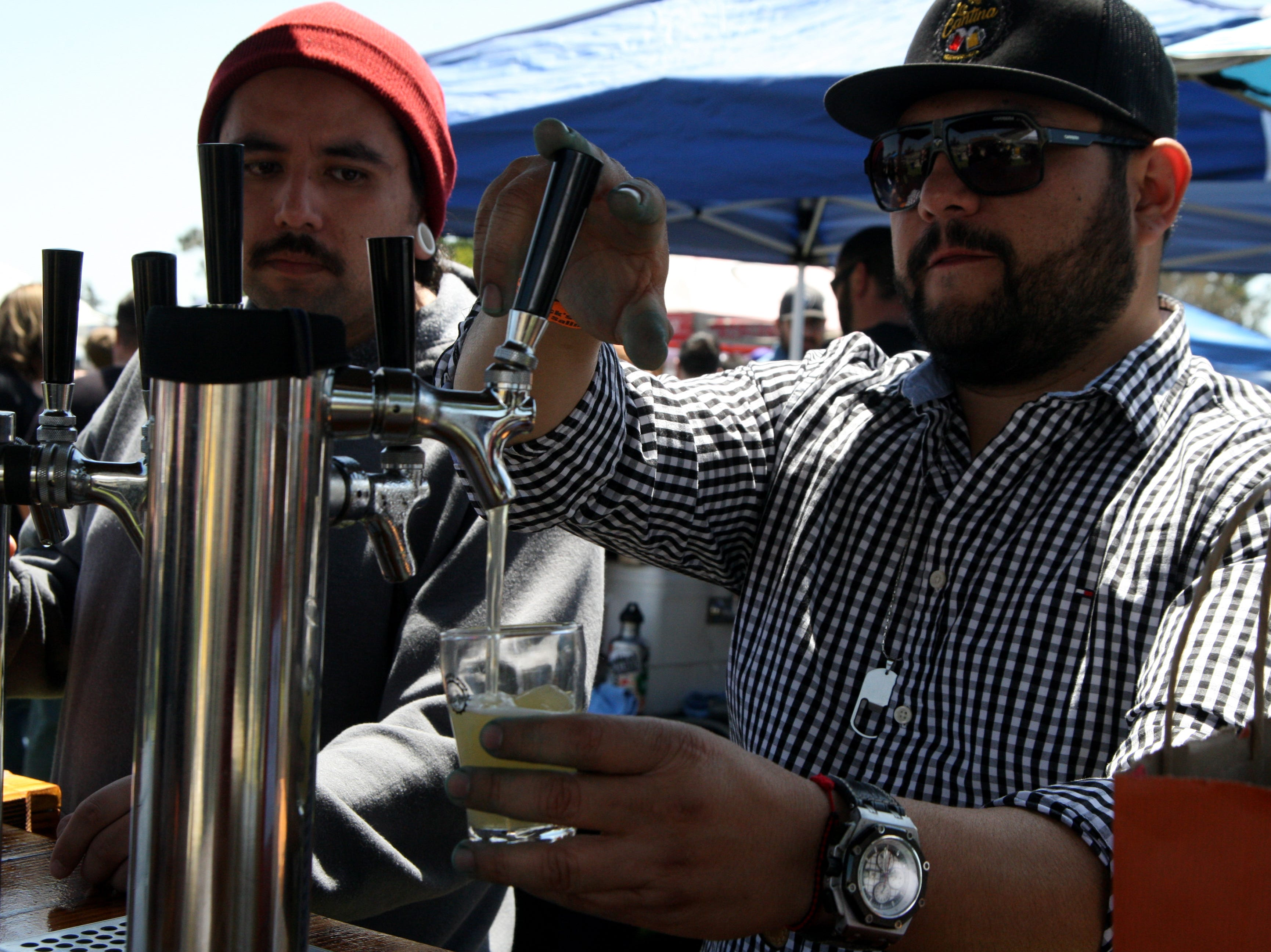 A home brewer pulls a beer at the Home Brew Fest. May 4, 2019.