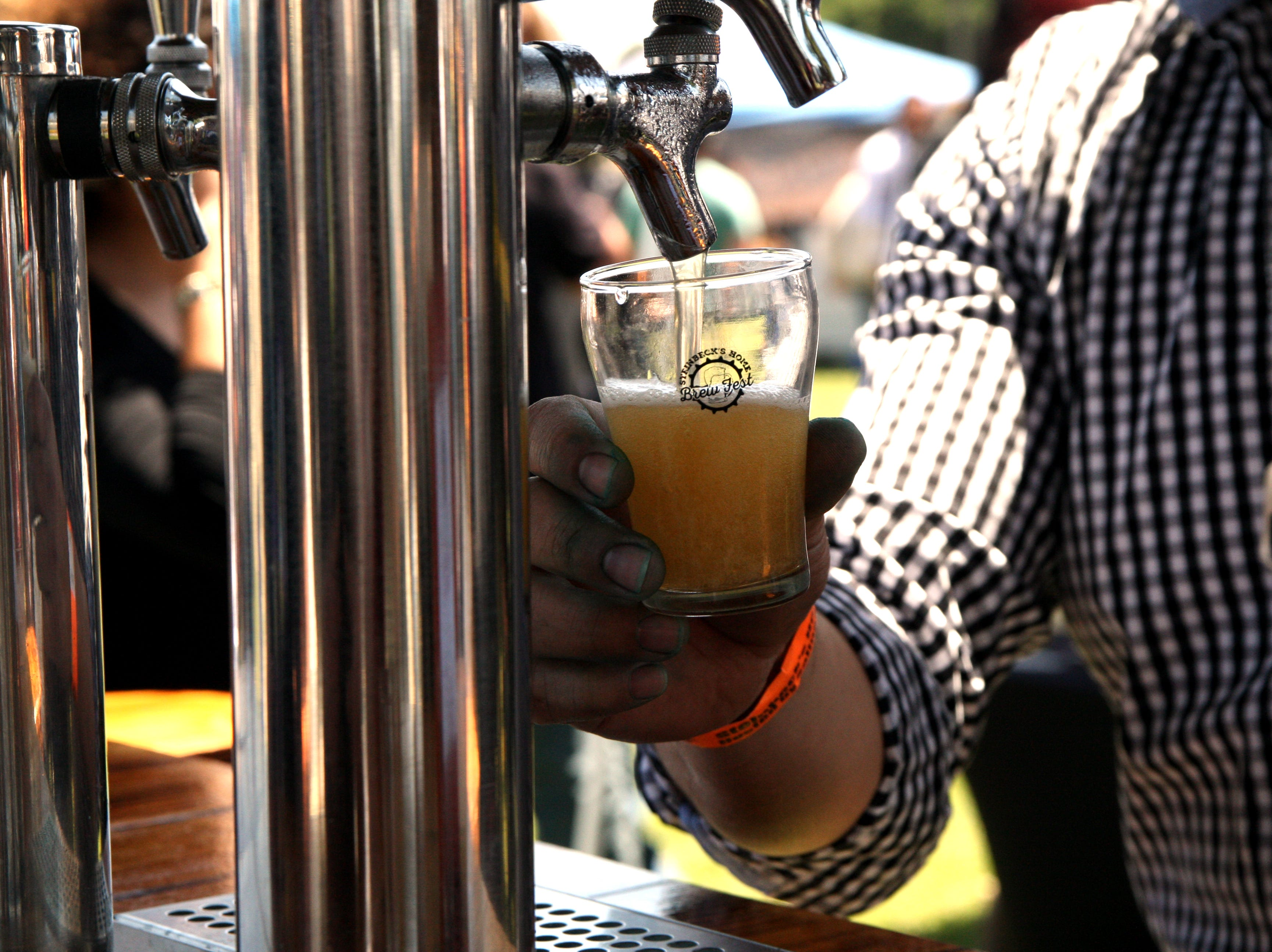 A home brewer pours a beer at the Steinbeck Home Brew Fest. May 4, 2019.