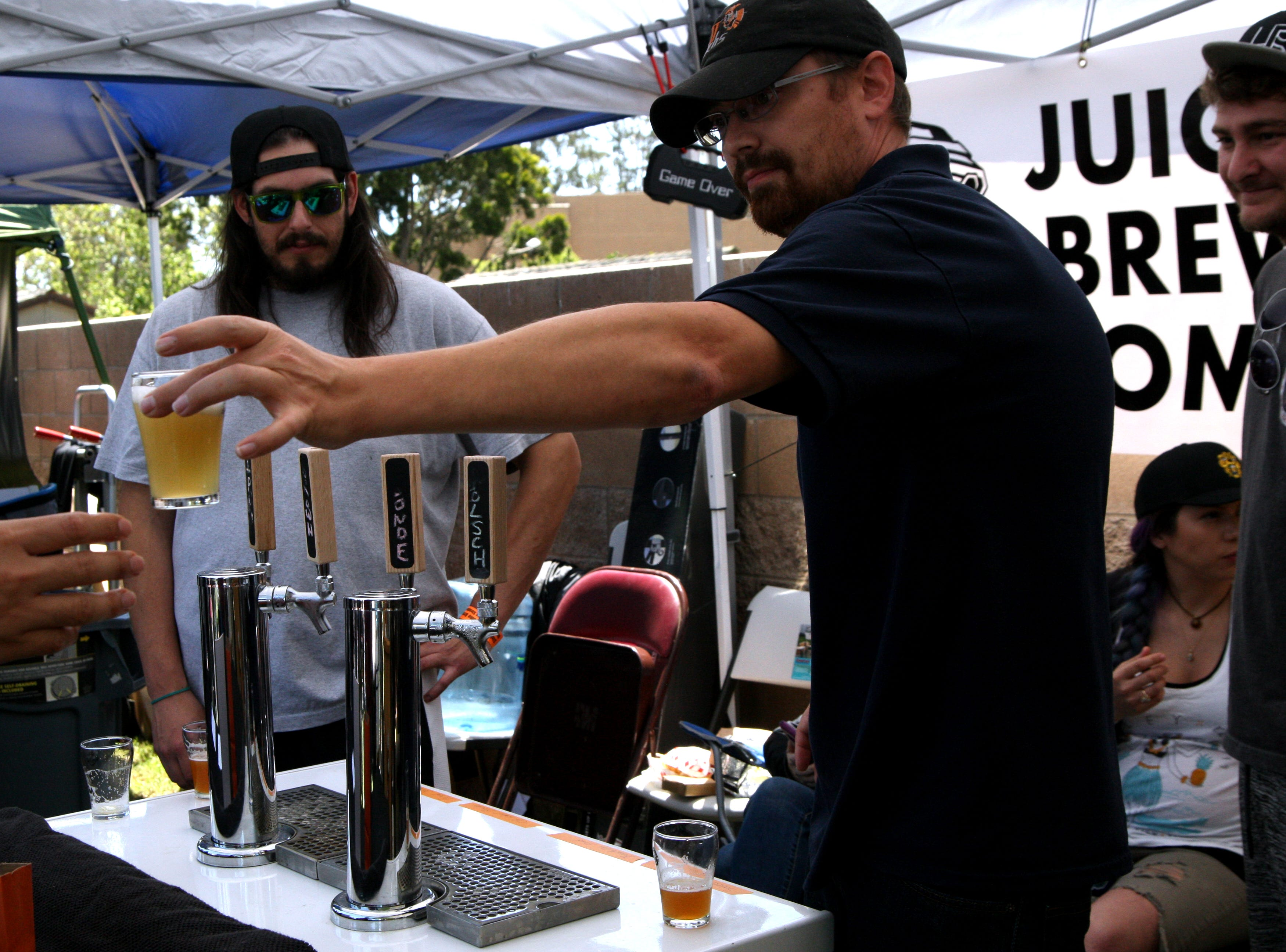 A home brewer for Juice Box pulls a beer for a customer. May 4, 2019.