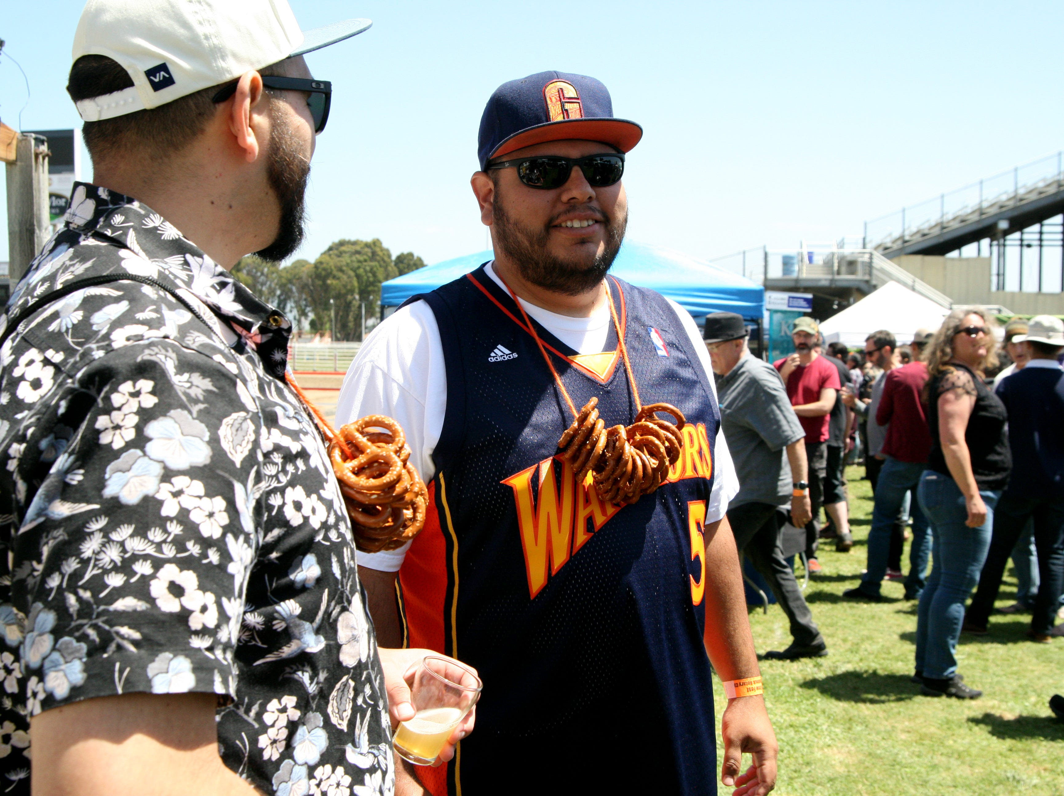 "Childhood friends Raul Palacio and Anthony Castillo made their own pretzel necklaces. ""We saw someone doing it at a Giants game and we've been doing it ever since when we go to brew fests,"" said Palacio. May 4, 2019."