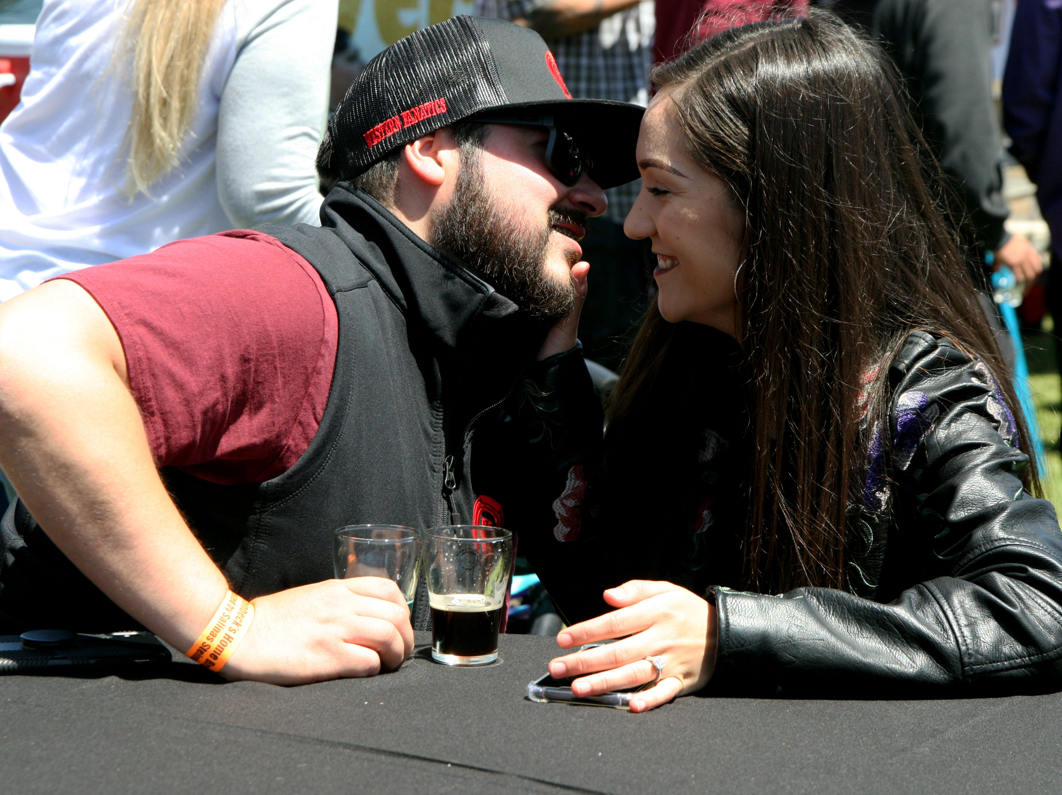 Chrystian Hernandez and Liz Andalon share a kiss and some beers at the brew fest. Hernandez had the blue 'Sour Belly' and the 'Pastel Mexicano.' May 4, 2019.