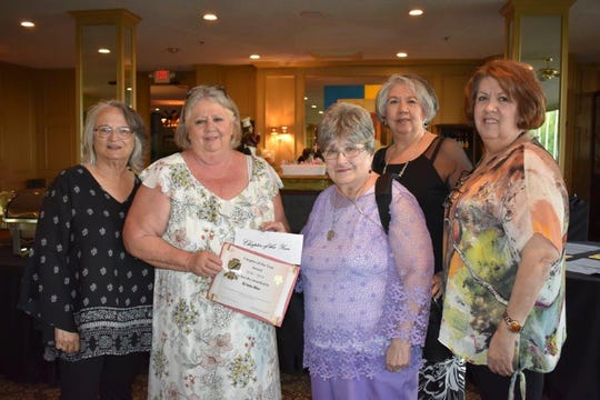 Grace Braziel presents the Chapter of the Year award to Beta Sigma Phi's Xi Iota Rho chapter. From left, Terry Casey, Donna Marro, Grace Braziel (presenter), Liz Tafoya-Castaneda and Martha Tafoya.