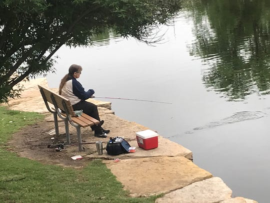 Marie Brock fishes patiently as she attempt to catch a catfish at the Concho River Saturday, May 4, 2019.