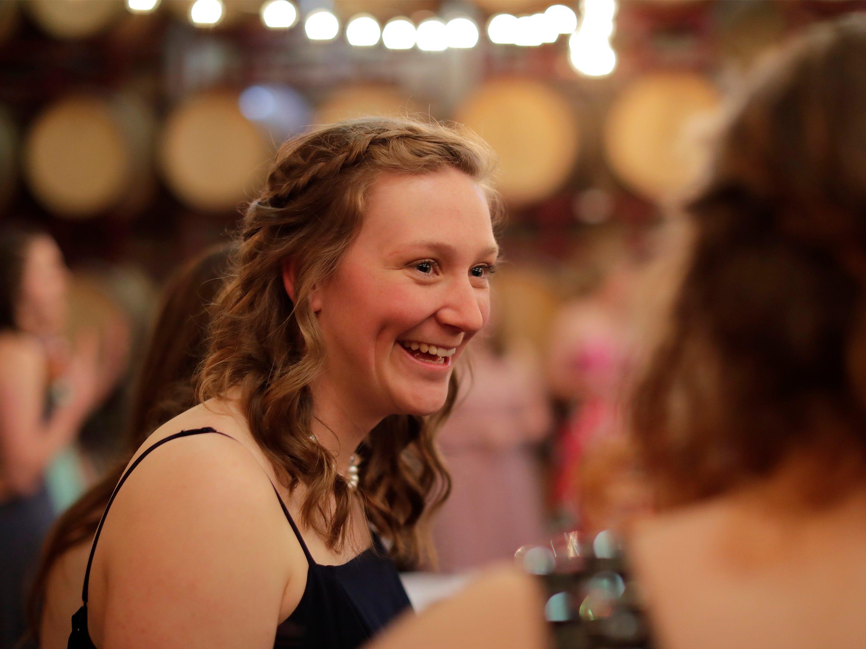 Ellie Steenwyk smiles at the Sheboygan Christian Junior-Senior Banquet, Friday, May 3, 2019, at The Blind Horse, in Kohler, Wis.
