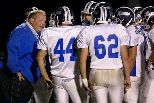 Random Lake coach Chris Bichler talks to his team during a 2007 game against Howards Grove.