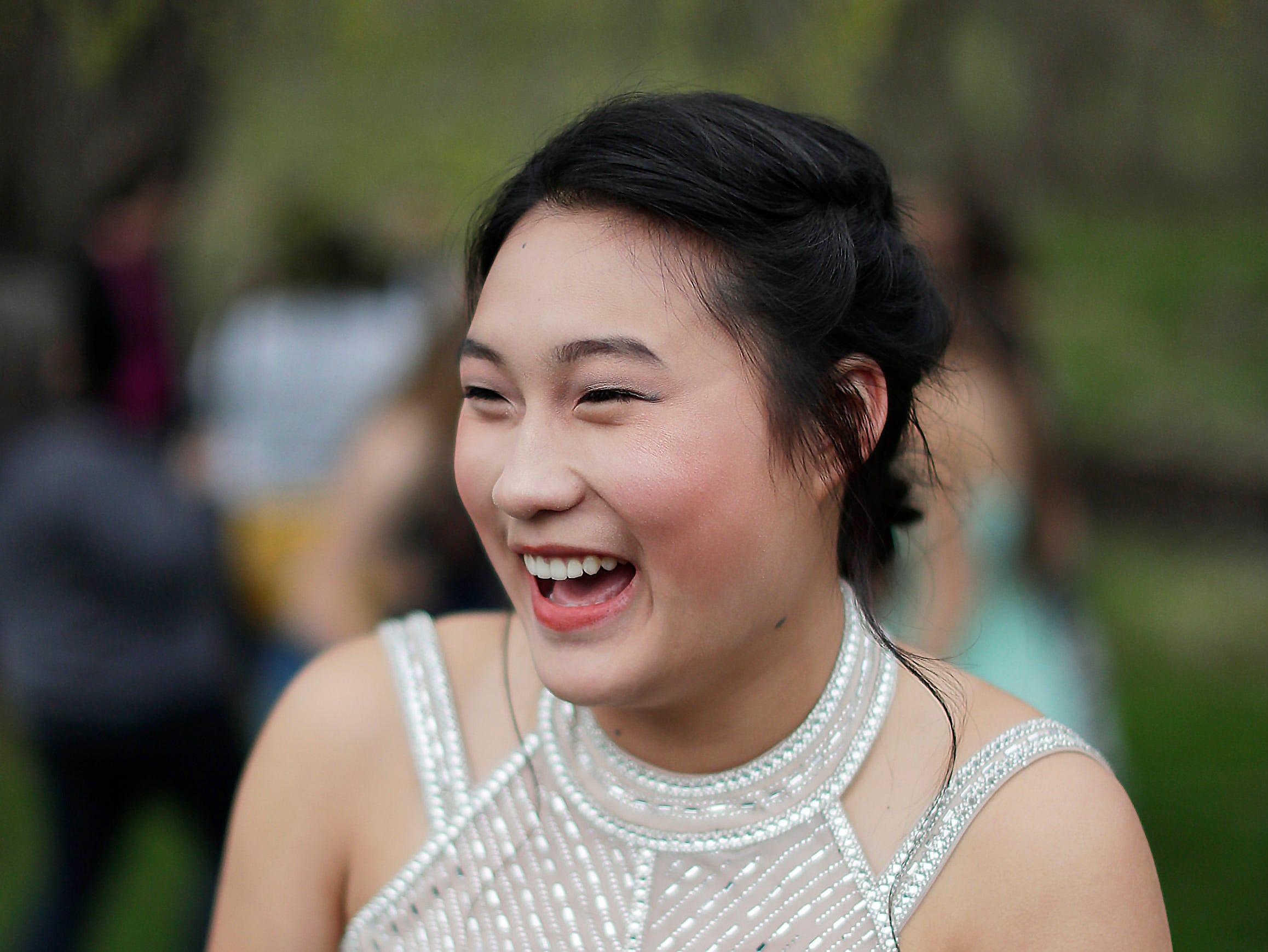 Thailand foreign exchange student Tulip Khandeeramongkol smiles during the Sheboygan Christian Junior-Senior Banquet, Friday, May 3, 2019, at The Blind Horse, in Kohler, Wis.