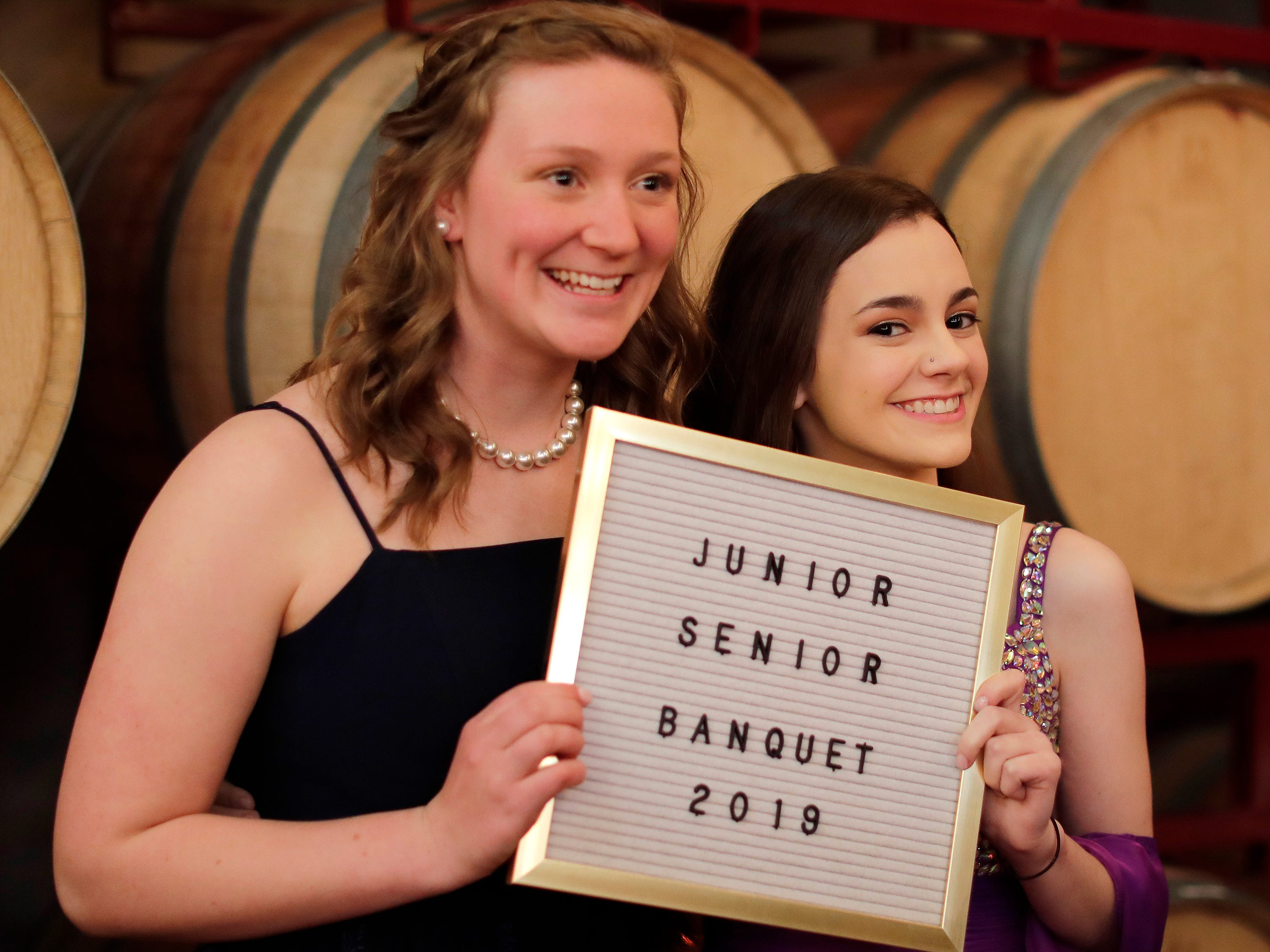 Ellie Steenwyk, left, and Annie Cornette pose at the Sheboygan Christian Junior-Senior Banquet, Friday, May 3, 2019, at The Blind Horse, in Kohler, Wis.