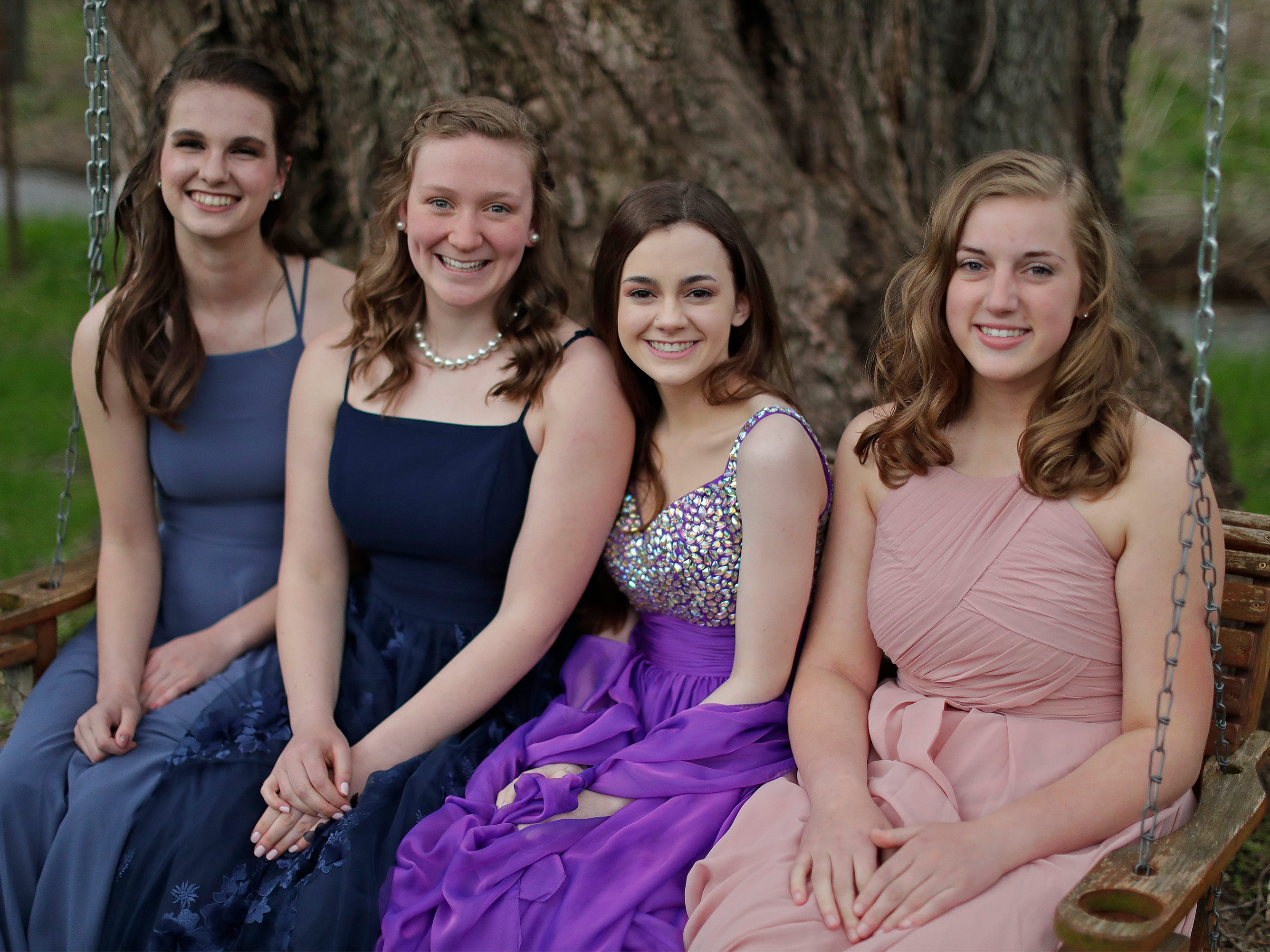 From Left: Isabelle Rahn, Ellie Steenwyk, Annie Cornette and Olivia Heimen pose at the Sheboygan Christian Junior-Senior Banquet, Friday, May 3, 2019, at The Blind Horse, in Kohler, Wis.