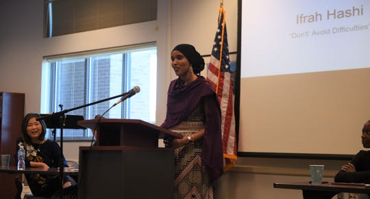 Ifrah Hashi, a senior at Lincoln High School, shares her immigration story at a storytelling event hosted by Siouxland Libraries on Saturday, May 4.