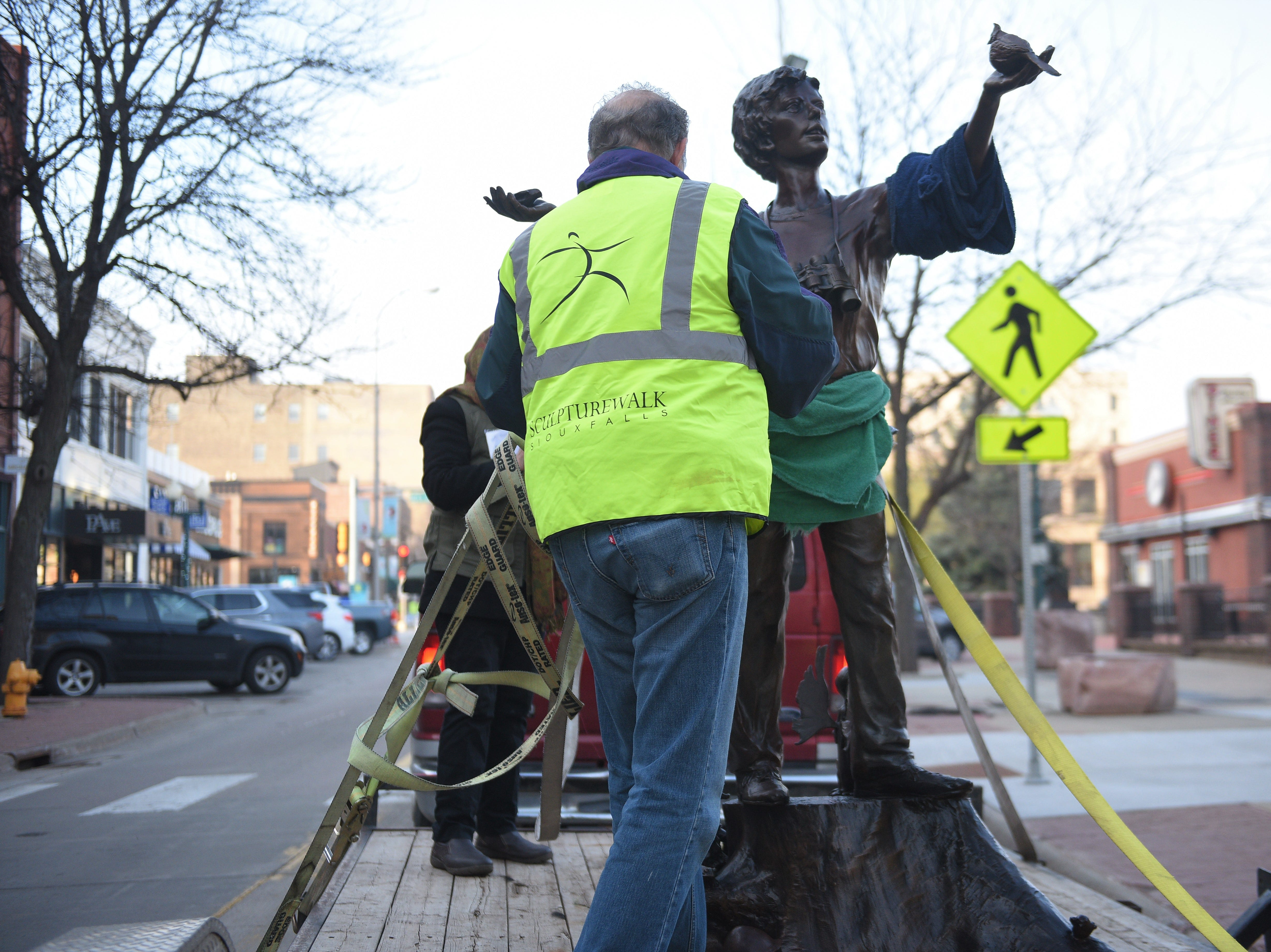 SculptureWalk Sioux Falls crews unload Bobbie Carlyle's sculpture to install it on Phillips Avenue Saturday, May 4, 2019, as part of the 16th Annual SculptureWalk Sioux Falls.