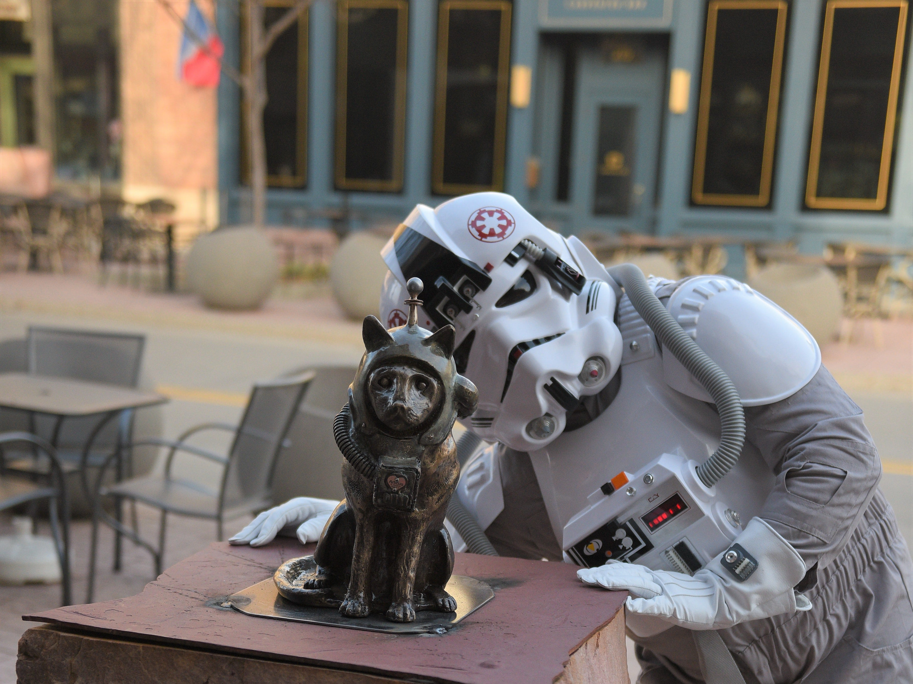"A Storm Trooper poses for a photo with SculptureWalk entry ""Space Cat"" in downtown Sioux Falls on Saturday, May 4, 2019, as the 59 new sculptures were installed."