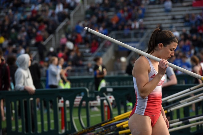 University of South Dakota's Helen Falda closes her eyes and pauses before competing in the women's pole vault competition at the Howard Wood Dakota Relays in Sioux Falls on Friday.