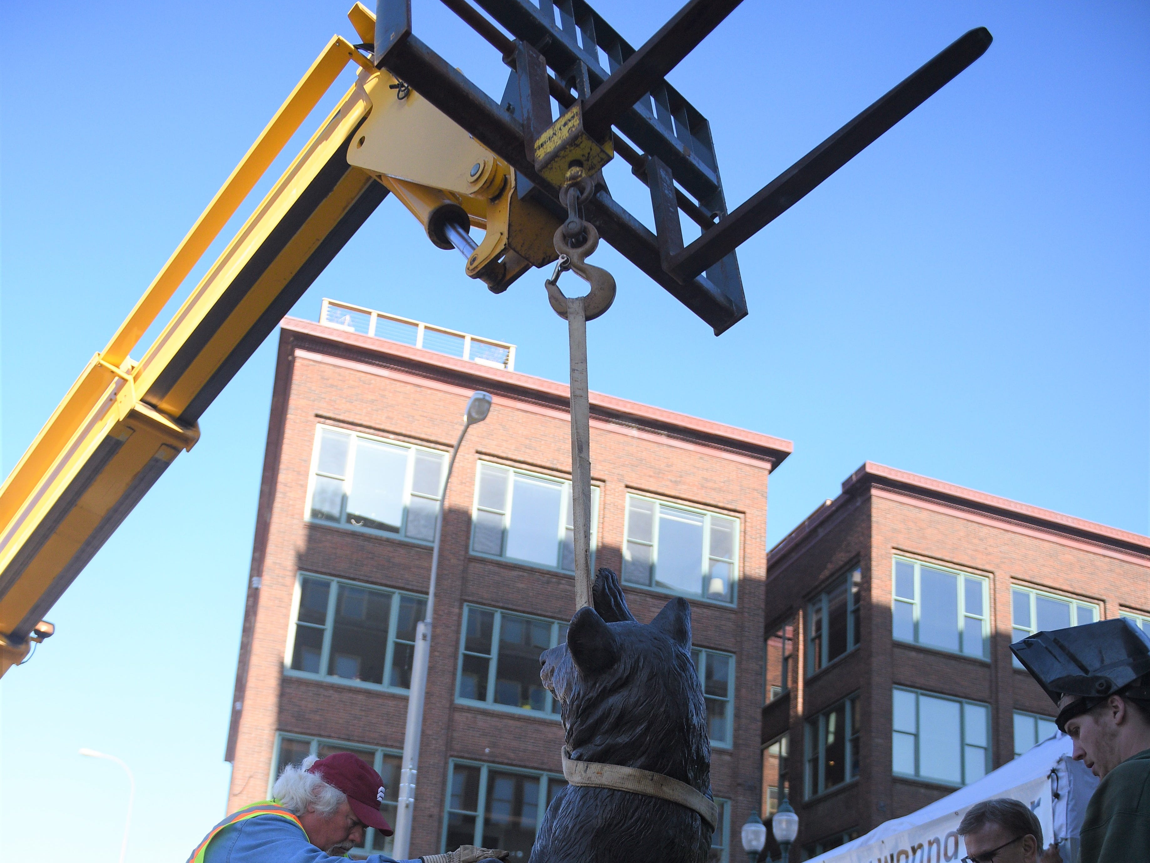 "Sculpture ""High Five"" is loaded onto its slate on Saturday, May 4, 2019, for the 16th Annual SculptureWalk Sioux Falls."