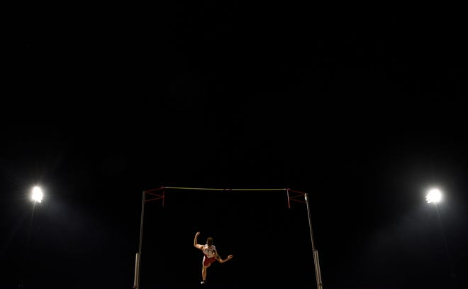 University of South Dakota junior Chris Nilsen clears the bar during the Howard Wood Dakota Relays Friday night in Sioux Falls. Multiple weather delays pushed much of the meet into the evening hours, and Nilsen's win in the men's pole vault was one of the final events.