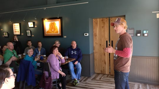 Bryan Deane Bertsch, brewmaster and owner at Deane's Kombucha in Minneapolis, talks about the fermentation process Saturday, May 4, at Jules' Bistro.