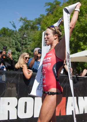 Holly Lawrence crosses the finish line of the St. George IRONMAN Saturday, May 4, 2019.