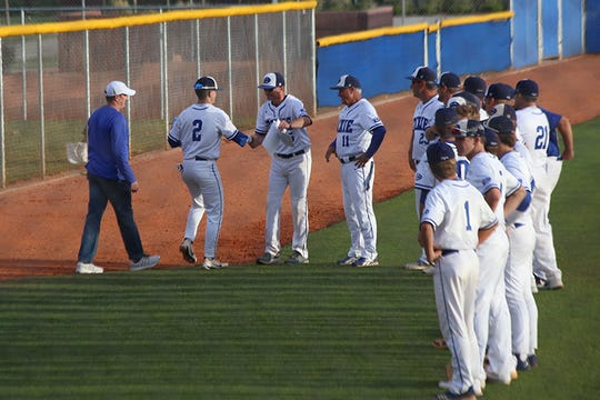 Asher Anderson (2) shakes hands with coach Danny Ipson during Dixie's senior night festivities.
