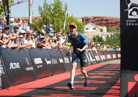 Jackson Laundry crosses the finish line of the St. George IRONMAN Saturday, May 4, 2019.