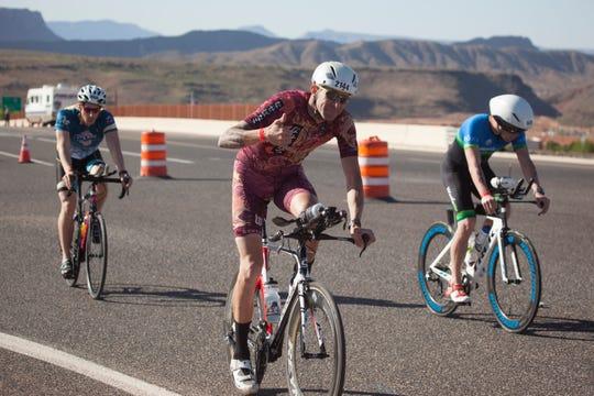 St. George Ironman contestants cross the Washington Parkway bridge Saturday, May 4, 2019.