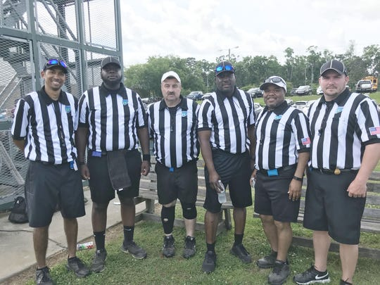 From left to right: Fred Thompson, Nigel Lascelles, Jim Davidson, Ernest Forrest, Dante Sailor and John Copeland of the Quincy Officials Association called multiple scrimmages at Lincoln High School on Saturday, May 4, 2019.