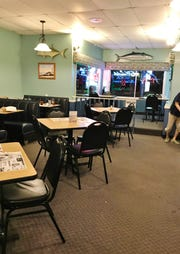 Dino's Restaurant decor is simple with cool aqua walls and a casual coastal vibe.