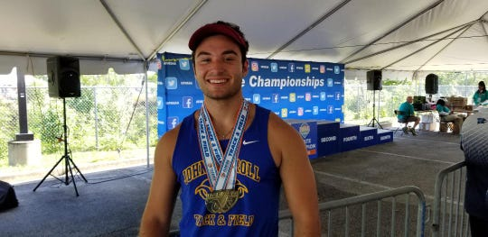 John Carroll Catholic senior thrower Jacob Hoeffner shows off his two gold medals from the Class 1A state track meet.