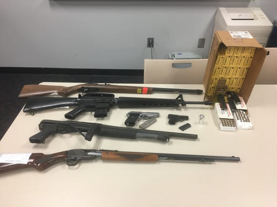 Firearms and ammunition seized during a search warrant in Oxnard on Thursday.