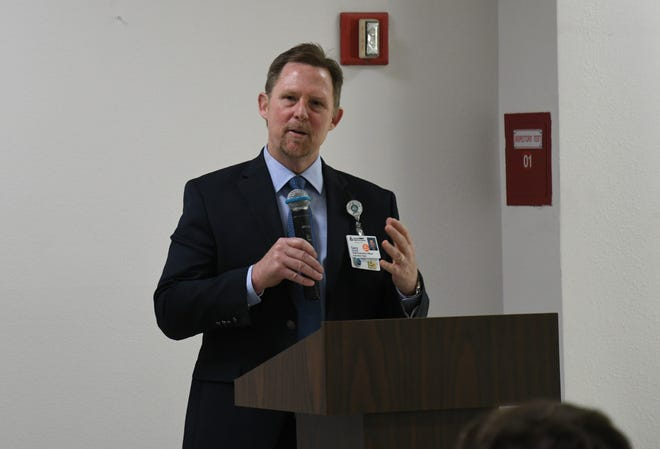 Kaweah Delta Medical Center CEO Gary Herbst addresses a roomful of volunteers and staff on Thursday at a community rally in Visalia's Industrial Park.