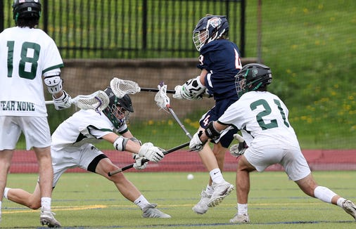 Briarcliff's Jack Ricciardi (4) fires a shot between Pleasantville's Ray Raefski (21) and Erik Roy (7) for a first half goal during boys lacrosse action at  Pleasantville High School May 4, 2019. Briacliff won the game 9-8.