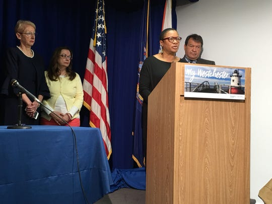 """Karen Cheeks-Lomax, CEO of My Sister's Place, speaks to reporters at the Westchester County office building prior to the signing of the """"Safe Leave"""" law on May 3, 2019."""