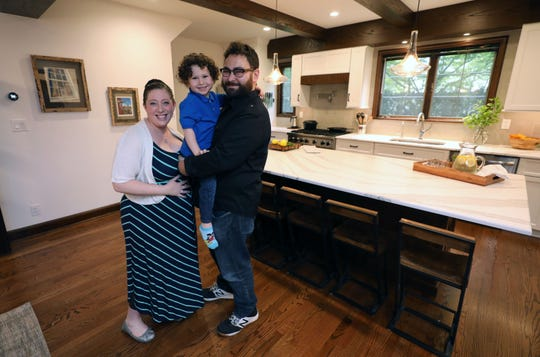 Sara Axelbaum, son Hudson, 4 and husband Mike are pictured in their renovated kitchen in their home in Bronxville, May 3, 2019. Three rooms on the first floor were gutted to make a very spacious and open kitchen and dining area.
