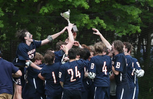 Briarcliff players celebrate with the Saw Mill Slugfest Cup after defeating Pleasantville 9-8 in boys lacrosse at Pleasantville High School May 4, 2019.