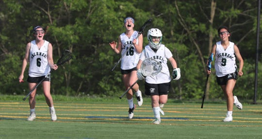 Archmere's (from left) Jennifer Olsen, Lexie Maloy, Maura Smeader and Tullis Liu celebrate after holding off an Ursuline rally to win, 15-14, at Archmere on May 3.