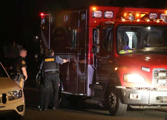 New Castle County police investigate after a person received a graze wound in a shooting on McMullen Avenue in Manor Park near New  Castle, reported about 8:40 p.m. Friday.