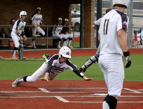 Archer City's Ty Bates reaches home to score against Alvord Saturday, May 4, 2019, at Hoskins Field. The Wildcats defeated the Bulldogs 11-1.
