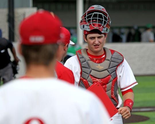 Holliday's Logan Whitling walks to the dugout on a changeover in Game 1 against Paradise Friday, May 3, 2019, in Iowa Park. The Eagles defeated the Panthers 5-4.