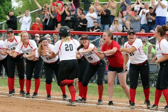 Rachel Eberling is congratulated by teammates after hitting a three-run homer in the fourth inning of Muskingum's 5-4 loss to Otterbein in the first round of the Ohio Athletic Conference Tournament on Friday at Donna Newberry Field.