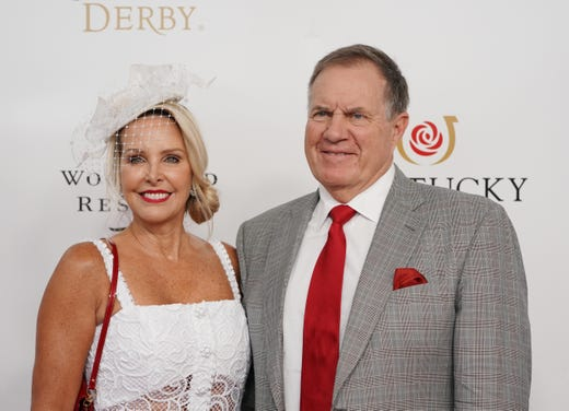 New England Patriots head coach Bill Belichick and girlfriend Linda Holliday arrive on the red carpet ahead of the Derby.