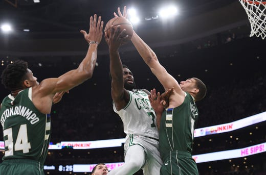 May 3: Boston Celtics guard Jaylen Brown (7) drives to the basket against Milwaukee Bucks forward Giannis Antetokounmpo and center Brook Lopez during the first half of Game 3.