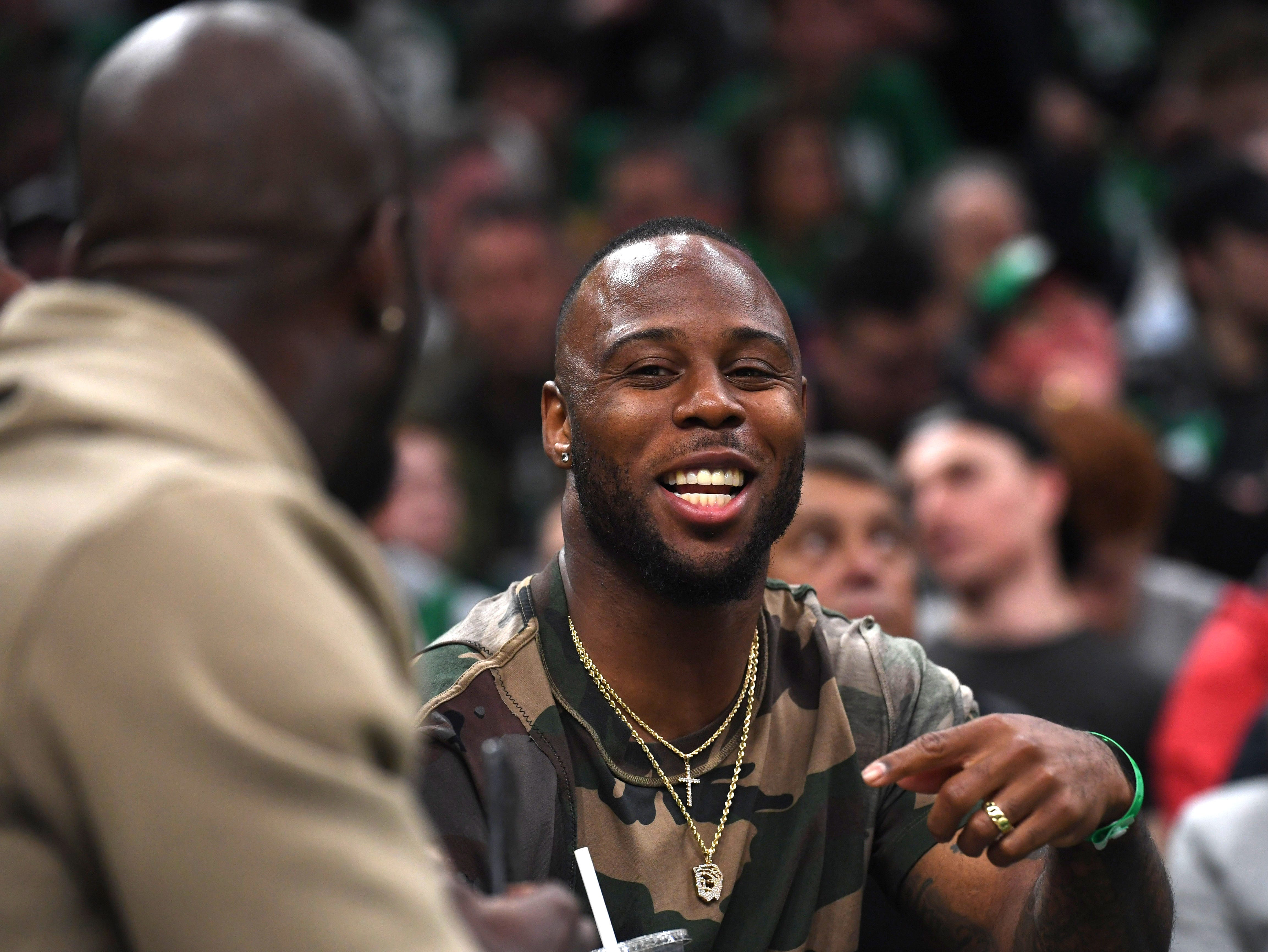May 3: New England Patriots running back James White talks with teammate Devon McCourty during the first half of Game 3 between the Boston Celtics and Milwaukee Bucks.