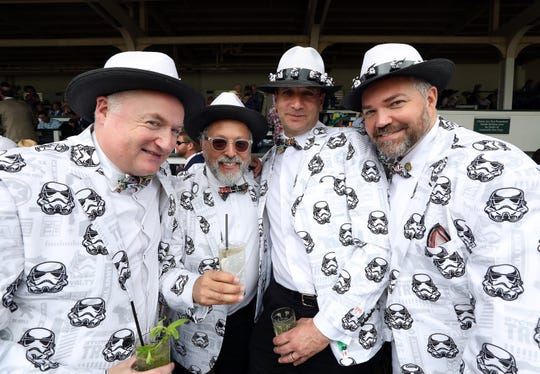 Rick Ross, Chris Kramer, Colin Bainen, and David Tate wear Star Wars attire for May the Fourth prior to the 145th running of the Kentucky Derby at Churchill Downs on May 04, 2019 in Louisville, Kentucky.