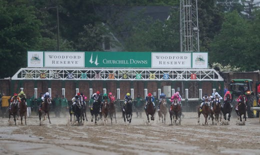 Horses race at the start of the 145th running of the Kentucky Derby.