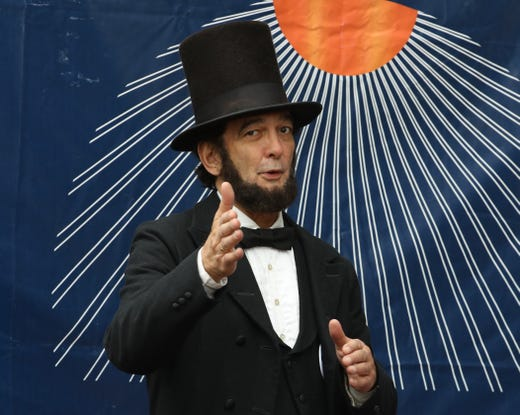 A fan is dressed as Abraham Lincoln.