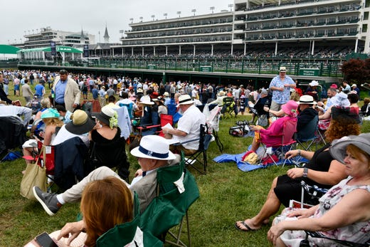 Fans get comfortable on the Churchill Downs infield before the 145th running of the Kentucky Derby.