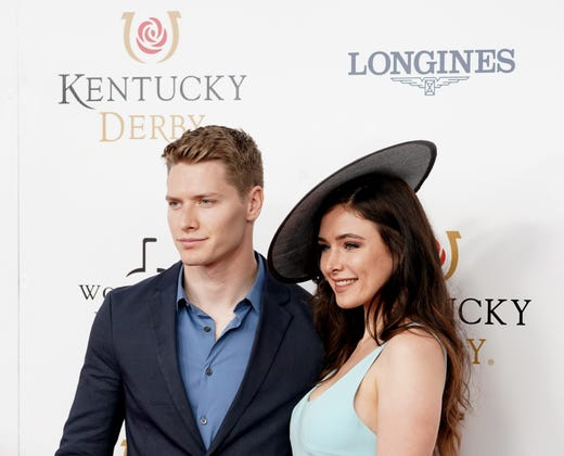 IndyCar Series driver Josef Newgarden and Ashley Welch arrive on the red carpet before the Derby.