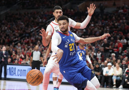 May 3: Denver Nuggets guard Jamal Murray (27) chases a loose ball against Portland Trail Blazers center Enes Kanter in the first half of Game 3.