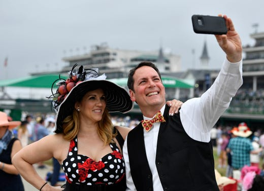 A couple pose for a photo in their derby attire.